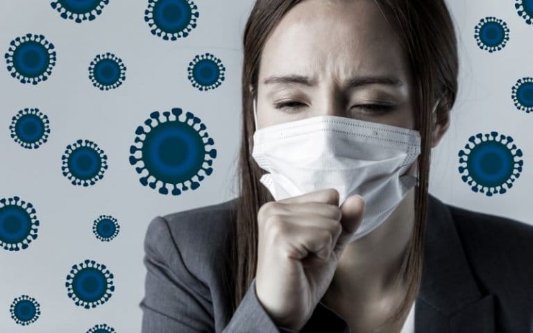 A female is coughing due to a virus