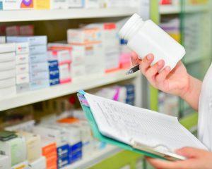 Pharmacist reading medicine label in a Pharmacy