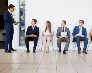 A recruitment officer is looking at people waiting for job interviews