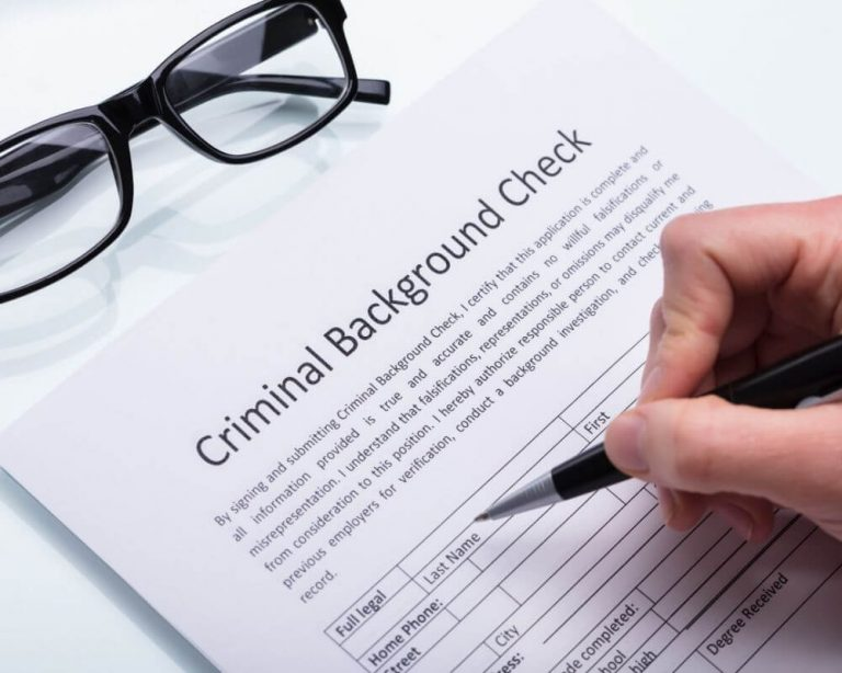 Person filling out a DBS form
